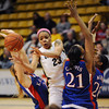 Chucky Jeffery of Colorado passes off to Courtney Dunn past Kelly Kohn, Carolyn Davis and Sade Morris , all of Kansas.<br /> Cliff Grassmick / February 16, 2010