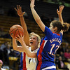 "Alyssa Fressle of Colorado splits the Kansas defense including Monica Engelman (13).<br /> For more photos of the game, go to  <a href=""http://www.dailycamera.com"">http://www.dailycamera.com</a>.<br /> Cliff Grassmick / February 16, 2010"