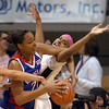 Carolyn Davis , left, of Kansas, gets tangled up with Brittany Spears of Colorado during the first half of the February 16, 2010 game in Boulder.<br /> Cliff Grassmick / February 16, 2010