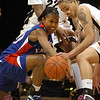 Sade Morris, left, of Kansas, and Chucky Jeffery of  Colorado, try to get a loose ball during the first half of the February 16, 2010 game in Boulder.<br /> Cliff Grassmick / February 16, 2010