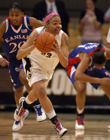 Chucky Jeffery of Colorado starts the fast break against Kansas Tuesday night.<br /> Cliff Grassmick / February 16, 2010