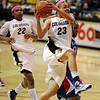 Chucky Jeffery of Colorado drives past Kansas to score.<br /> Cliff Grassmick / February 16, 2010