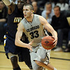 "Austin Dufault of CU drives around Justin Greene of Kent State.<br /> For more photos of the game, go to  <a href=""http://www.dailycamera.com"">http://www.dailycamera.com</a>.<br /> Cliff Grassmick / March 22, 2011"