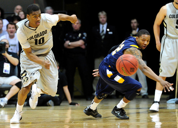 CU's Alec Burks snags a loose ball away from Rodriquez Sherman of Kent State.<br /> Photo by Marty Caivano/March 22, 2011