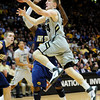CU's Levi Knutson pushes to shoot against Kent State.<br /> Photo by Marty Caivano/March 22, 2011