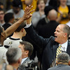 "Alec Burks has a high five for Tad Boyle.<br /> For more photos of the game, go to  <a href=""http://www.dailycamera.com"">http://www.dailycamera.com</a>.<br /> Cliff Grassmick / March 22, 2011"