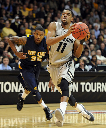 """Cory Higgins of CU drives past Rodriquez Sherman of Kent State.<br /> For more photos of the game, go to  <a href=""""http://www.dailycamera.com"""">http://www.dailycamera.com</a>.<br /> Cliff Grassmick / March 22, 2011"""