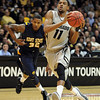 "Cory Higgins of CU drives past Rodriquez Sherman of Kent State.<br /> For more photos of the game, go to  <a href=""http://www.dailycamera.com"">http://www.dailycamera.com</a>.<br /> Cliff Grassmick / March 22, 2011"