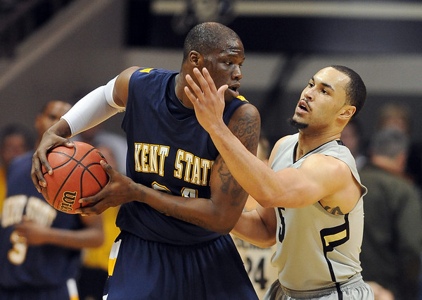 "Marcus Relphorde of CU pressures  Justin Greene of Kent State.<br /> For more photos of the game, go to  <a href=""http://www.dailycamera.com"">http://www.dailycamera.com</a>.<br /> Cliff Grassmick / March 22, 2011"