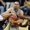 "Marcus Relphorde gets  fouled near the end of the game.<br /> For more photos of the game, go to  <a href=""http://www.dailycamera.com"">http://www.dailycamera.com</a>.<br /> Cliff Grassmick / March 22, 2011"