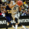 CU's Cory Higgins drives past Rodriquez Sherman of Kent State.<br /> Photo by Marty Caivano/March 22, 2011