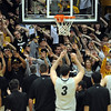 "The fans and players sing at the end of the game.<br /> For more photos of the game, go to  <a href=""http://www.dailycamera.com"">http://www.dailycamera.com</a>.<br /> Cliff Grassmick / March 22, 2011"