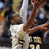 "Shannon Sharpe of CU drives on Justin Greene of Kent State.<br /> For more photos of the game, go to  <a href=""http://www.dailycamera.com"">http://www.dailycamera.com</a>.<br /> Cliff Grassmick / March 22, 2011"