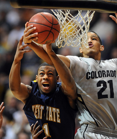 """Eric Gaines, left, of Kent State, battles with Andre Roberson of CU.<br /> For more photos of the game, go to  <a href=""""http://www.dailycamera.com"""">http://www.dailycamera.com</a>.<br /> Cliff Grassmick / March 22, 2011"""