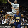 "Alec Burks of CU drives past Rodriquez Sherman of Kent State.<br /> For more photos of the game, go to  <a href=""http://www.dailycamera.com"">http://www.dailycamera.com</a>.<br /> Cliff Grassmick / March 22, 2011"