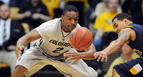 """Shannon Sharpe of CU knocks the ball from Michael Porrini of Kent State.<br /> For more photos of the game, go to  <a href=""""http://www.dailycamera.com"""">http://www.dailycamera.com</a>.<br /> Cliff Grassmick / March 22, 2011"""