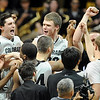 "Trent Buckley, left, and Ben Mills, celebrate the win with teammates.<br /> For more photos of the game, go to  <a href=""http://www.dailycamera.com"">http://www.dailycamera.com</a>.<br /> Cliff Grassmick / March 22, 2011"