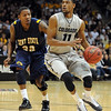 "Cory Higgins of CU looks to pass over Rodriquez Sherman of Kent State.<br /> For more photos of the game, go to  <a href=""http://www.dailycamera.com"">http://www.dailycamera.com</a>.<br /> Cliff Grassmick / March 22, 2011"