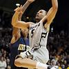 "Marcus Relphorde dunks on Kent State on Tuesday.<br /> For more photos of the game, go to  <a href=""http://www.dailycamera.com"">http://www.dailycamera.com</a>.<br /> Cliff Grassmick / March 22, 2011"