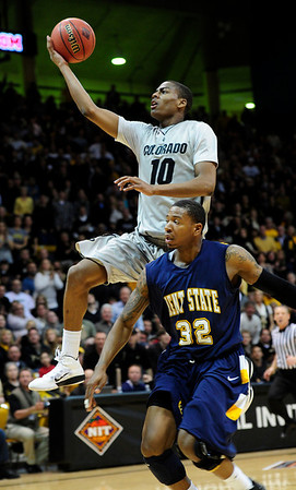 CU's Alec Burks shoots over Rodriquez Sherman of Kent State.<br /> Photo by Marty Caivano/March 22, 2011