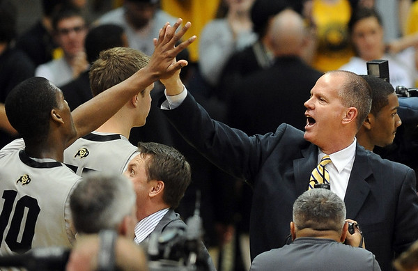 """Alec Burks has a high five for Tad Boyle.<br /> For more photos of the game, go to  <a href=""""http://www.dailycamera.com"""">http://www.dailycamera.com</a>.<br /> Cliff Grassmick / March 22, 2011"""