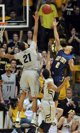 """Andre Roberson of CU goes up high to block the shot of Michael Porrini of Kent State.<br /> For more photos of the game, go to  <a href=""""http://www.dailycamera.com"""">http://www.dailycamera.com</a>.<br /> Cliff Grassmick / March 22, 2011"""