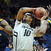 "Alec Burks of CU drives past Carlton Guyton (11) of Kent State.<br /> For more photos of the game, go to  <a href=""http://www.dailycamera.com"">http://www.dailycamera.com</a>.<br /> Cliff Grassmick / March 22, 2011"