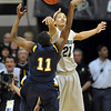 "Andre Roberson of CU, blocks the shot of Carlton Guyton of Kent State.<br /> For more photos of the game, go to  <a href=""http://www.dailycamera.com"">http://www.dailycamera.com</a>.<br /> Cliff Grassmick / March 22, 2011"