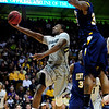 CU's Shannon Sharpe gets a shot past Justin Manns of Kent State.<br /> Photo by Marty Caivano/March 22, 2011