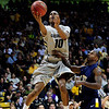 CU's Alec Burks gets a shot past Randal Holt of Kent State.<br /> Photo by Marty Caivano/March 22, 2011