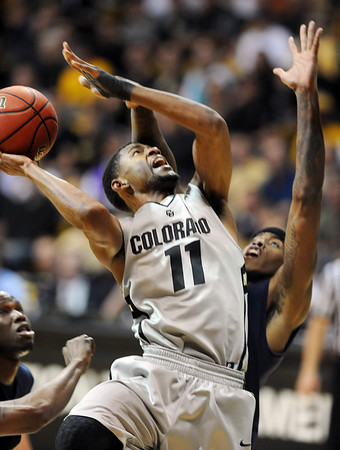 "Cory Higgins of CU  goes to the hole against Kent State.<br /> For more photos of the game, go to  <a href=""http://www.dailycamera.com"">http://www.dailycamera.com</a>.<br /> Cliff Grassmick / March 22, 2011"