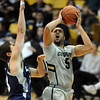 "Marcus Relphorde of Colorado puts up a shot on Jan Van Der Kooij of Longwood.<br /> For more photos of the game, go to  <a href=""http://www.dailycamera.com"">http://www.dailycamera.com</a>.<br /> Cliff Grassmick / December 19, 2010"