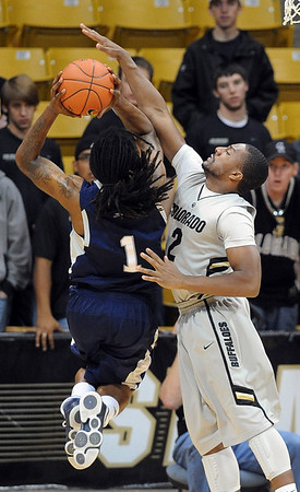 "Shannon Sharpe of Colorado tries to block the shot of  Jeremiah Bowman of Longwood.<br /> For more photos of the game, go to  <a href=""http://www.dailycamera.com"">http://www.dailycamera.com</a>.<br /> Cliff Grassmick / December 19, 2010"