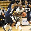 "Shannon Sharpe of Colorado tries to drive around Jeremiah Bowman of Longwood.<br /> For more photos of the game, go to  <a href=""http://www.dailycamera.com"">http://www.dailycamera.com</a>.<br /> Cliff Grassmick / December 19, 2010"