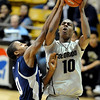 Alec Burks of Colorado drives to the basket against Aaron Mitchell of Longwood, during the second half of the December 19, 2010 game in Boulder.<br /> Cliff Grassmick / December 19, 2010