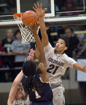 Andre Roberson (21) of Colorado, goes up to block the shot of Jeremiah Bowman of Longwood, during the first half of the game in Boulder.<br /> Cliff Grassmick / December 19, 2010