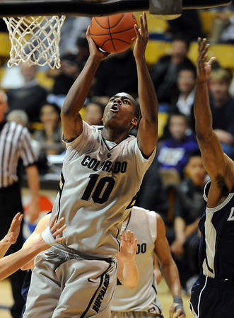 """Alec Burks of Colorado drives to the basket against Longwood, during the second half of the December 19, 2010 game in Boulder.<br /> For more photos of the game, go to  <a href=""""http://www.dailycamera.com"""">http://www.dailycamera.com</a>.<br /> Cliff Grassmick / December 19, 2010"""