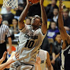 "Alec Burks of Colorado drives to the basket against Longwood, during the second half of the December 19, 2010 game in Boulder.<br /> For more photos of the game, go to  <a href=""http://www.dailycamera.com"">http://www.dailycamera.com</a>.<br /> Cliff Grassmick / December 19, 2010"