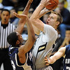 "Trey Eckloff of Colorado shoots over Martiz Washington of Longwood.<br /> For more photos of the game, go to  <a href=""http://www.dailycamera.com"">http://www.dailycamera.com</a>.<br /> Cliff Grassmick / December 19, 2010"