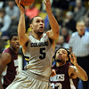 "Marcus Relphorde of CU drives past Dishawn Bradshaw of UMES.<br /> For more photos of the game, go to  <a href=""http://www.dailycamera.com"">http://www.dailycamera.com</a>.<br /> Cliff Grassmick / December 29, 2010"