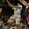 "Shannon Sharpe of Colorado drives past Louis Bell of Maryland Eastern Shore.<br /> For more photos of the game, go to  <a href=""http://www.dailycamera.com"">http://www.dailycamera.com</a>.<br /> Cliff Grassmick / December 29, 2010"