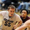 """Trey Eckloff puts a move on Dishawn Bradford of UMES.<br /> For more photos of the game, go to  <a href=""""http://www.dailycamera.com"""">http://www.dailycamera.com</a>.<br /> Cliff Grassmick / December 29, 2010"""