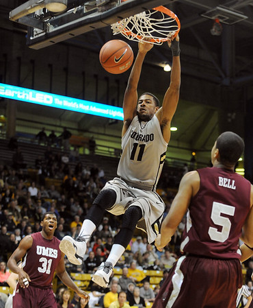 "Cory Higgins of Colorado dunks against Maryland Eastern Shore on Wednesday.<br /> For more photos of the game, go to  <a href=""http://www.dailycamera.com"">http://www.dailycamera.com</a>.<br /> Cliff Grassmick / December 29, 2010"
