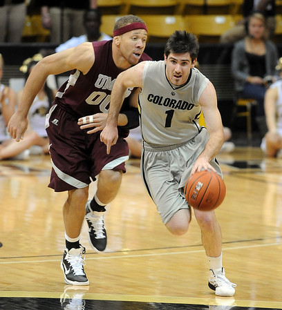 """Nate Tomlinson starts the fast break on UMES.<br /> For more photos of the game, go to  <a href=""""http://www.dailycamera.com"""">http://www.dailycamera.com</a>.<br /> Cliff Grassmick / December 29, 2010"""