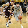 "Nate Tomlinson starts the fast break on UMES.<br /> For more photos of the game, go to  <a href=""http://www.dailycamera.com"">http://www.dailycamera.com</a>.<br /> Cliff Grassmick / December 29, 2010"