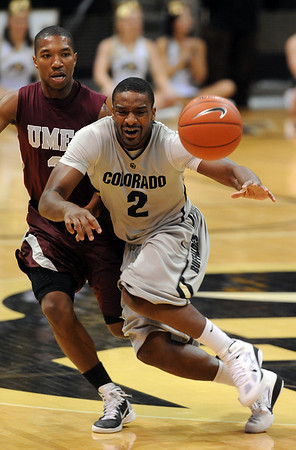 """Shannon Sharpe of CU throws a pass in front of Kevin White of UMES.<br /> For more photos of the game, go to  <a href=""""http://www.dailycamera.com"""">http://www.dailycamera.com</a>.<br /> Cliff Grassmick / December 29, 2010"""