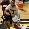 "Shannon Sharpe of CU throws a pass in front of Kevin White of UMES.<br /> For more photos of the game, go to  <a href=""http://www.dailycamera.com"">http://www.dailycamera.com</a>.<br /> Cliff Grassmick / December 29, 2010"