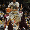"Alec Burks of Colorado, looks to pass around Tyler Hines (32) of Maryland Eastern Shore during the first half of the December 29, 2010 game in Boulder.<br /> For more photos of the game, go to  <a href=""http://www.dailycamera.com"">http://www.dailycamera.com</a>.<br /> Cliff Grassmick / December 29, 2010"