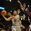 Marcus Relphorde of Colorado, drives past Tyler Hines of Maryland Eastern Shore, during the first half of the December 29th, 2010 game in Boulder.<br /> Cliff Grassmick / December 29, 2010