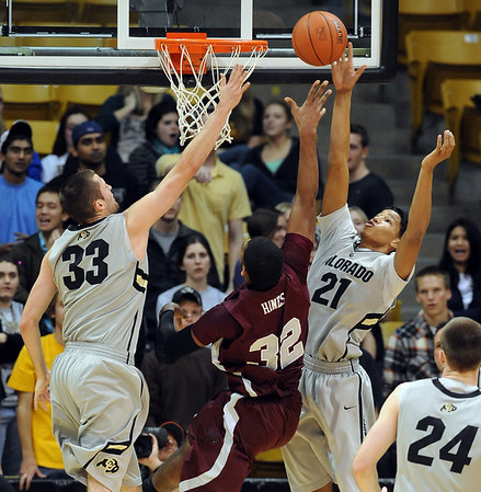 "Austin Dufault, left, and Andre Roberson of CU put the defense on Tyler Hines of UMES.<br /> For more photos of the game, go to  <a href=""http://www.dailycamera.com"">http://www.dailycamera.com</a>.<br /> Cliff Grassmick / December 29, 2010"